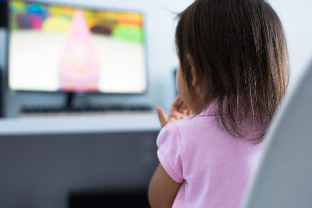 child watching cartoons on tv